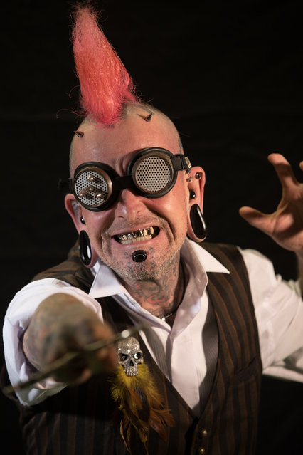 Sword swallower Hannibal Hellmurto poses for a photograph prior to a rehearsal of the Circus of Horrors' latest show Voodoo, ahead of Halloween, at the Wookey Hole Caves Theatre near Wells on October 19, 2017 in Somerset, England. (Photo by Matt Cardy/Getty Images)