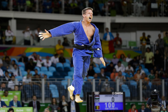 Belgium's Dirk Van Tichelt celebrates after winning a bronze medal in the men's 73-kg judo competition at at the 2016 Summer Olympics in Rio de Janeiro, Brazil, Monday, August 8, 2016. (Photo by Markus Schreiber/AP Photo)