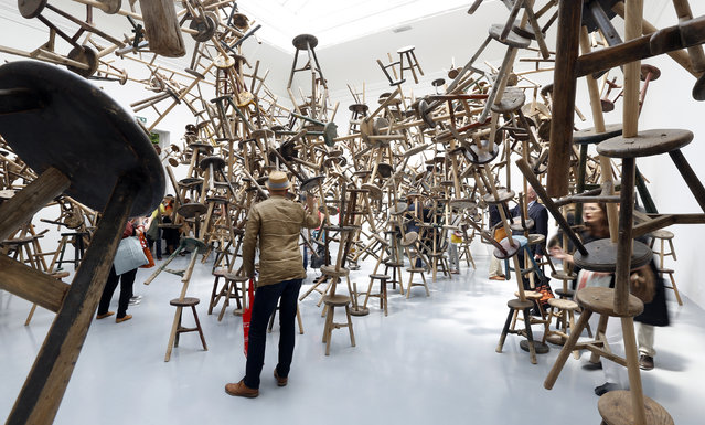 """Visitors look at the installation called """"Bang"""" by China's artist Ai Weiwei at the German pavilion during the 55th La Biennale of Venice May 29, 2013. (Photo by Stefano Rellandini/Reuters)"""