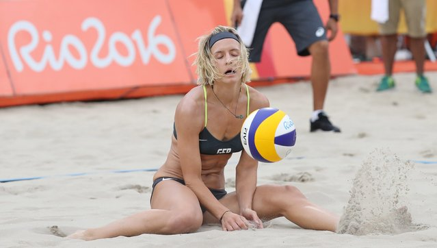 Laura Ludwig of Germany reacts as she and Kira Walkenhorst play Larissa Franca Maestrini and Talita Rocha of Brazil during their Rio 2016 Olympic Games Women's Semifinal at the Beach Volleyball Arena on Copacabana Beach in Rio de Janeiro, Brazil, 16 August 2016. (Photo by Mario Ruiz/EPA)