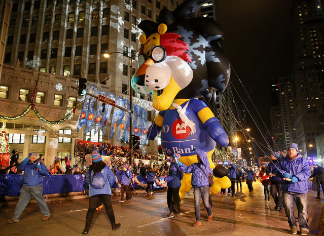Performers take part in the 26th Magnificent Mile Light Festival Parade at North Michigan Avenue in Chicago, the United States, Nov. 18, 2017. With dozens of floats, dancing and performance presented by local art groups and high schools, this parade marked the beginning of annual holiday season. (Photo by Wang Ping/Xinhua/Barcroft Images)