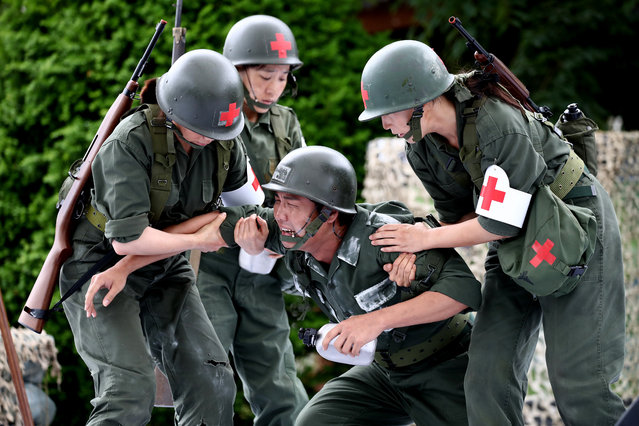 South Korean performers participate in a re-enactment of the battle of the Korean war during the ceremony to mark the 70th anniversary of the Korean War in Cheorwon, near the border with North Korea on June 25, 2020 in Cheorwon, South Korea. Over 66,000 South Koreans have been separated from their families during the Korean War which started on June 25, 1950, and effectively split the Korean Peninsula into two over the 3-year conflict. The fighting between North and South Korea ended on July 27, 1953, with the signing of the Korean Armistice Agreement and the heavily guarded Demilitarized Zone was created, however, both countries remain technically still at war since no peace agreement was signed and many Koreans died before they could reunite with their loved ones. (Photo by Chung Sung-Jun/Getty Images)