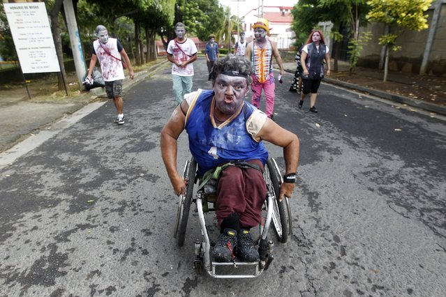 A man on a wheelchair dressed as zombie takes part in a zombie race to raise funds for children with cancer at the child Hospital Manuel de Jesus Rivera in Managua October 19, 2014. (Photo by Oswaldo Rivas/Reuters)