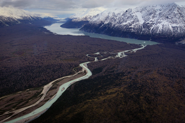 A river flows from a lake fed by the Melburn Glacier in Tatshenshini-Alsek Park, as seen during a flight over northwest British Columbia, October 7, 2014. (Photo by Bob Strong/Reuters)