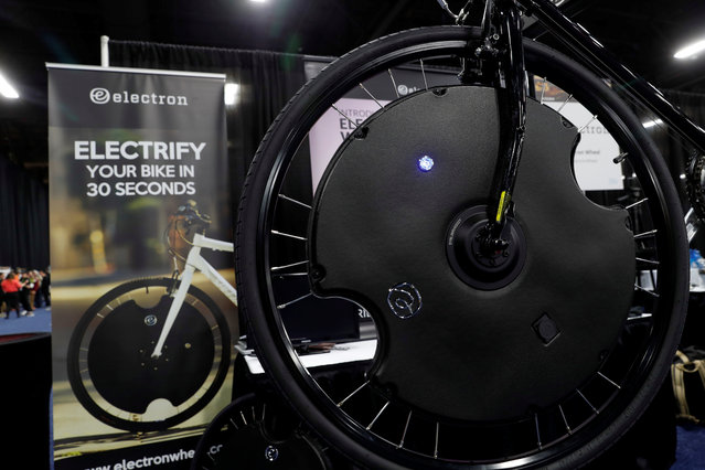 An Electron Wheel is shown on a bicycle during CES Unveiled at the 2018 CES in Las Vegas, Nevada, U.S. January 8, 2018. (Photo by Steve Marcus/Reuters)