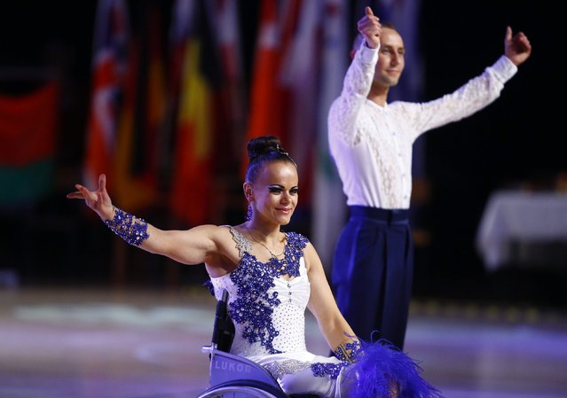 Hanna Stasiuk and Ihar Kuliashou of Belarus celebrate as they win gold in Combi Lat 1 competition during IPC Wheelchair Dance Sport European Championships in Lomianki near Warsaw, November 9, 2014. (Photo by Kacper Pempel/Reuters)