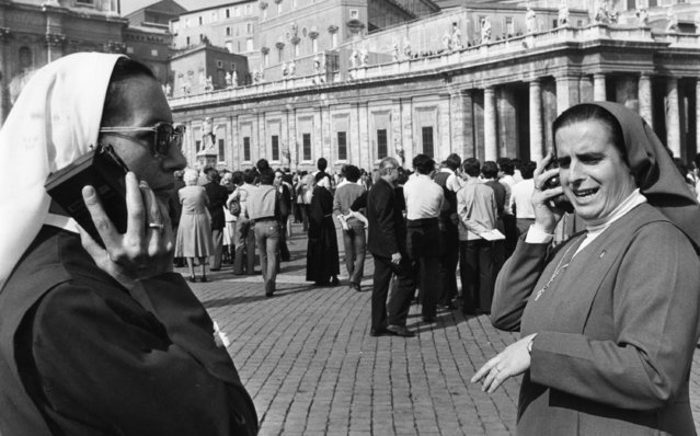 Two nuns with their transistor radios listening to the Vatican radio station October 16, 1978 to get the final confirmation that today's smoke out of the Sistine Chapel again indicated that no new Pope has been found by the conclavists after the sixth balloting. (Photo by AP Photo)