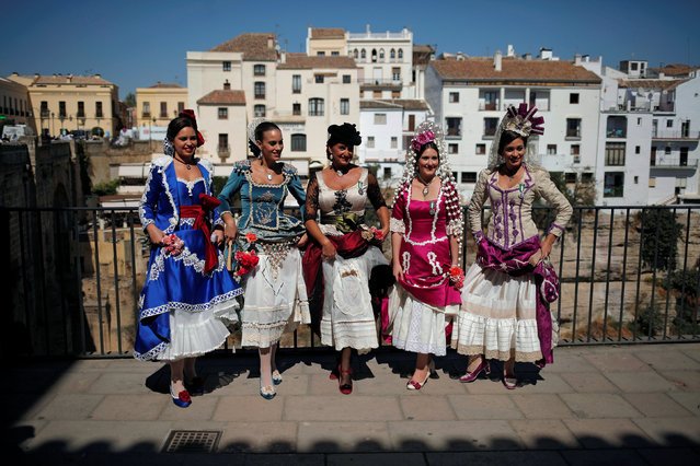 Women wearing traditional Goyesca dresses pose for tourists to commemorate the World Tourism Day in Ronda, southern Spain September 27, 2016. (Photo by Jon Nazca/Reuters)