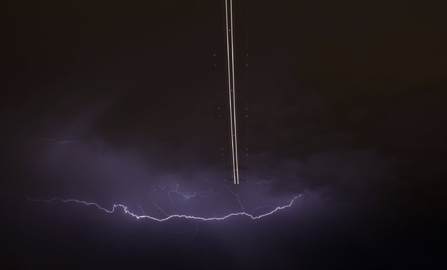 A jet aircraft takes off as lightning strikes across the sky during a monsoon storm at McCarran International Airport in Las Vegas, Nevada, in this July 7, 2014 file photo. (Photo by Gene Blevins/Reuters)