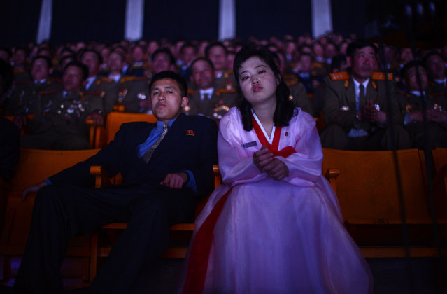 North Koreans watch a theater performance during celebrations to mark the 100th birth anniversary of Kim Il Sung, in Pyongyang, on April 16, 2012. (Photo by Pedro Ugarte/AFP Photo)
