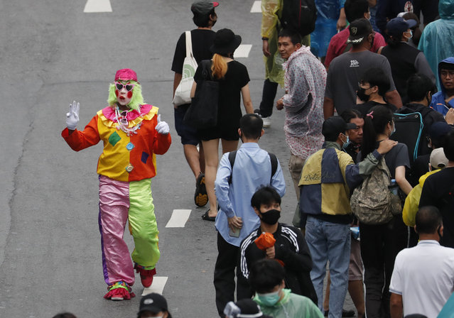 A pro-democracy protester dresses as clown during a protest near a main train station in Bangkok, Thailand, Saturday, October 17, 2020. (Photo by Sakchai Lalit/AP Photo)