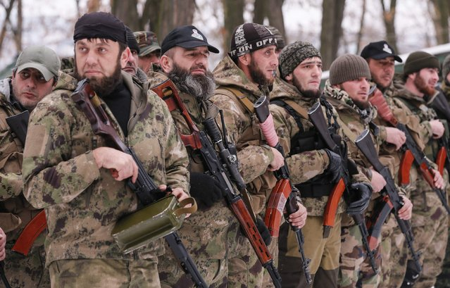 """Pro-Russian separatists from the Chechen """"Death"""" battalion stand in a line during a training exercise in the territory controlled by the self-proclaimed Donetsk People's Republic, eastern Ukraine, December 8, 2014. (Photo by Maxim Shemetov/Reuters)"""