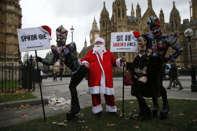 Protesters take part in a demonstration against new laws on p*rnography outside parliament in central London December 12, 2014. (Photo by Stefan Wermuth/Reuters)