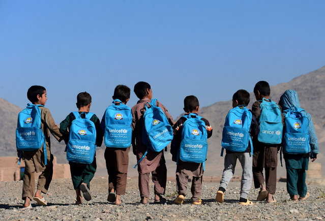 Afghan children walk to school on the outskirts of Herat on October 10, 2016. (Photo by Aref Karimi/AFP Photo)