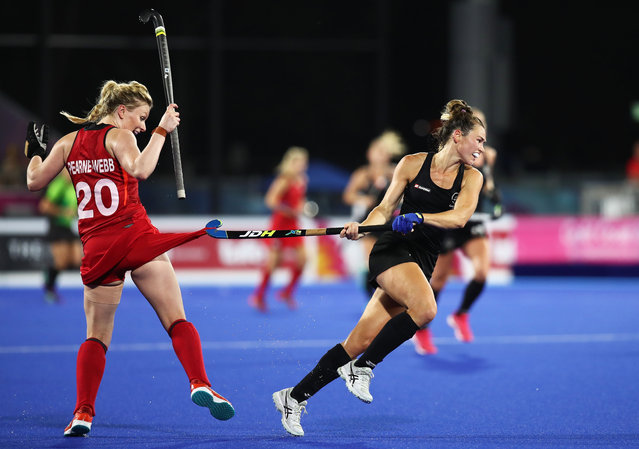 Kelsey Smith of New Zealand gets her stick caught on the shorts of Hollie Pearne-Webb of England during Women's Semi Final Hockey match between England and New Zealand on day eight of the Gold Coast 2018 Commonwealth Games at Gold Coast Hockey Centre on April 12, 2018 on the Gold Coast, Australia. (Photo by Matt King/Getty Images)