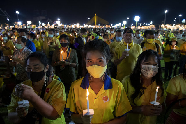Supporters of the monarchy participate in a candle lighting ceremony to mark the anniversary of the birth of late King Bhumibol Adulyadej at Sanam Luang ceremonial ground in Bangkok, Thailand, Saturday, December 5, 2020. (Photo by Gemunu Amarasinghe/AP Photo)