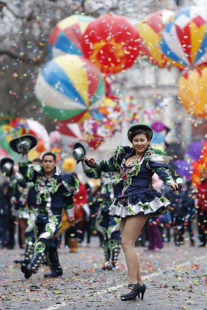 """Performers from Bolivia's """"Caporales San Simon Londres"""" take part in the New Year's Day Parade in London on Janurary 1, 2015. (Photo by Justin Tallis/AFP Photo)"""