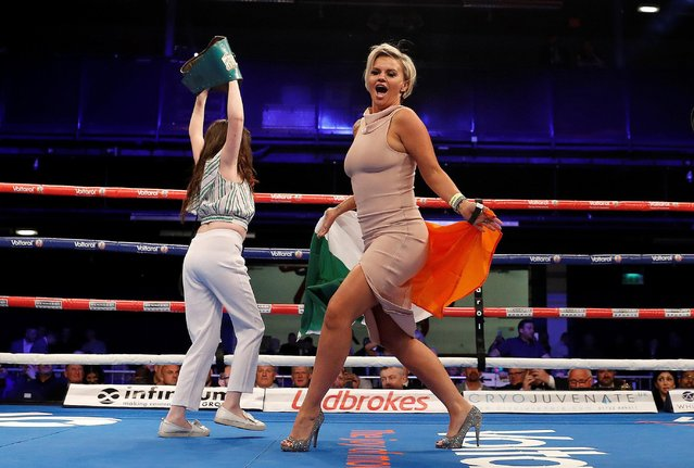 Kerry Katona carries Peter McDonagh's flag before he faces Peter Krame during their Super welterweight bout at the Bolton Whites Hotel, Bolton, United Kingdom on May 12, 2018. (Photo by Lee Smith/Action Images via Reuters)