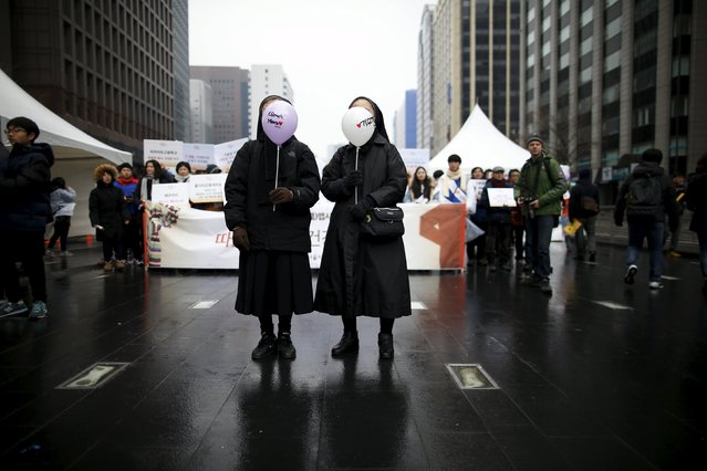 Nuns holding balloons prepare to march during a rally ahead of the 2015 Paris Climate Change Conference, known as the COP21, in central Seoul, South Korea, November 29, 2015. (Photo by Kim Hong-Ji/Reuters)