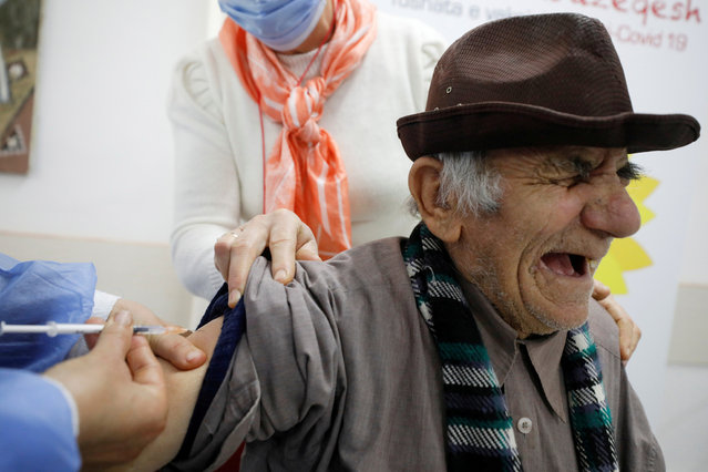 A healthcare worker administers a dose of the Pfizer-BioNTech coronavirus disease (COVID-19) vaccine to an elderly man, at an elderly house in Fier, Albania, February 19, 2021. (Photo by Florion Goga/Reuters)