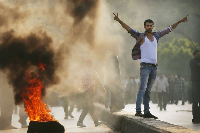 Supporters of former Egyptian President Mohammed Morsi burn tires along a bridge in protest over his removal by the Egyptian military in Cairo, Egypt, on July 6, 2013. (Photo by Spencer Platt/Getty Images)