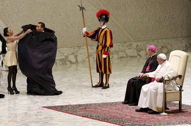 Circus artists perform in front of Pope Francis during the Wednesday general audience in Paul VI hall at the Vatican January 28, 2015. (Photo by Alessandro Bianchi/Reuters)