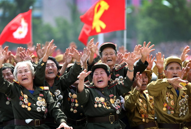 North Korean war veterans cry as they parade past their leader Kim Jong Un, Saturday, July 27, 2013 during a mass military parade celebrating the 60th anniversary of the Korean War armistice in Pyongyang, North Korea. (Photo by Wong Maye-E/AP Photo)