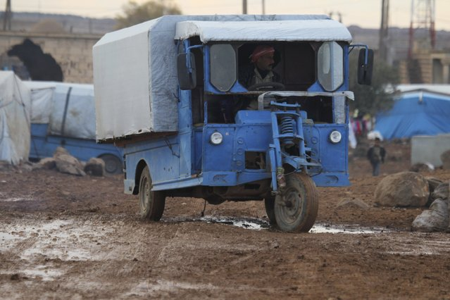 A man rides a vehicle inside a refugee camp for internally displaced Syrians in the Hama countryside, Syria January 1, 2016. (Photo by Ammar Abdullah/Reuters)