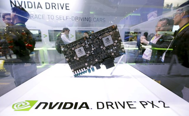 A Nvidia Drive PX 2 computer for autonomous vehicles is displayed during the 2016 CES trade show in Las Vegas, Nevada January 8, 2016. Nvidia says the the new Drive PX 2 platform, designed for autonomous cars, can process 24 trillion deep learning operations a second. (Photo by Steve Marcus/Reuters)