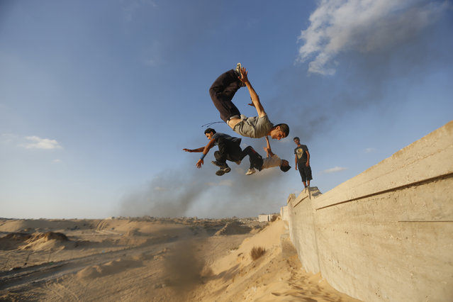 Palestinian youths practice their parkour skills in Khan Younis in the southern Gaza Strip, September 12, 2012. (Photo by Mohammed Salem/Reuters)