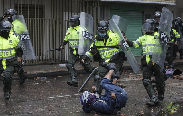 Anti-government protester clashes with police in Bogota, Colombia, Wednesday, June 9, 2021. (Photo by Ivan Valencia/AP Photo)