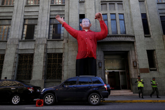 A giant inflatable doll of former Venezuela's late President Hugo Chavez is seen in downtown Caracas, Venezuela December 5, 2016. (Photo by Ueslei Marcelino/Reuters)