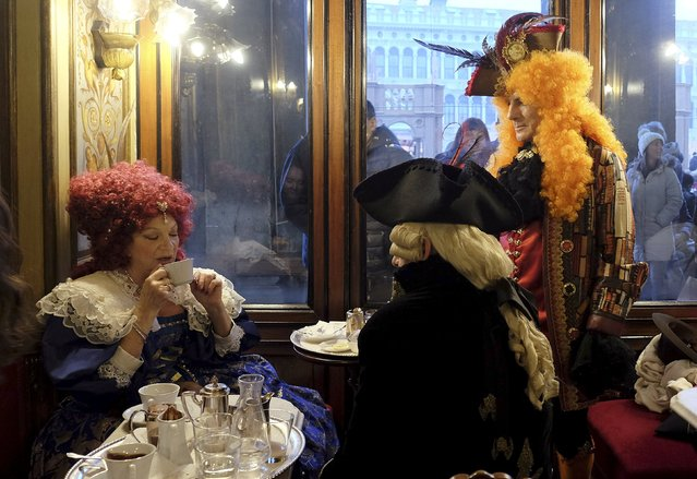Revellers are seen in the Caffe Florian coffee shop in Saint Mark's Square during the Venice Carnival, Italy January 31, 2016. (Photo by Manuel Silvestri/Reuters)