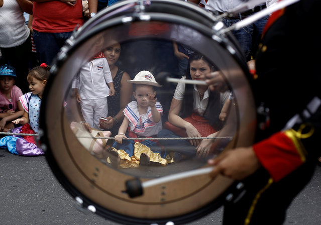 COSTA RICA: Children look at students taking part in a parade commemorating Costa Rica's Independence Day in San Jose, Costa Rica, September 15, 2016. (Photo by Juan Carlos Ulate/Reuters)