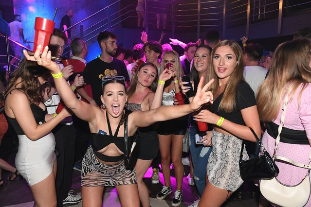 Partygoers dance the night away on July 19, 2021 at Astoria Nightclub in Portsmouth, Hampshire, United Kingdom which opened its doors at 12:01am on Monday. (Photo by Paul Jacobs/Picture Exclusive)