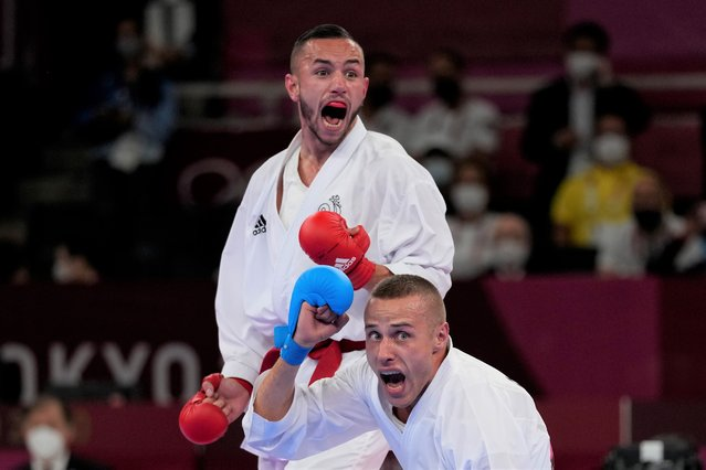 Steven de Costa of France, top, and Kalvis Kalnins of Latvia react during the men's kumite -67kg elimination round for Karate at the 2020 Summer Olympics, Thursday, August 5, 2021, in Tokyo, Japan. (Photo by Vincent Thian/AP Photo)