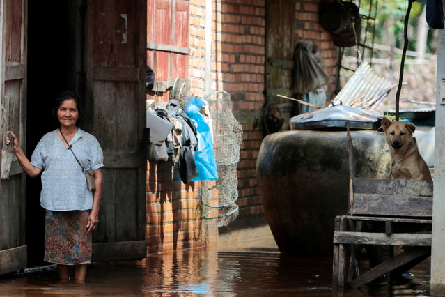 Reang On-nuan stands next to her flooded house at Cha-uat district in Nakhon Si Thammarat Province, southern Thailand, January 18, 2017. (Photo by Surapan Boonthanom/Reuters)