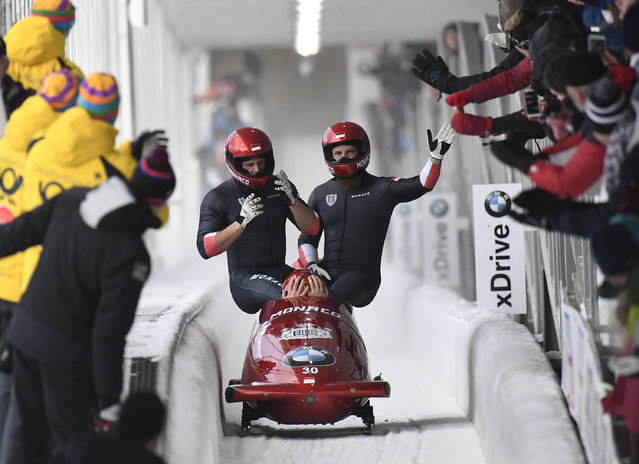 Driver Rudy Rinaldi, Boris Vain, Thibault Demarthon, and brakeman Mendonnaca Steven Borges of Monaco celebrate after crashing and recovering to arrive in the finish area after their second run in the four-man Bobsled World Cup Saturday, February 16, 2019, in Lake Placid, N.Y. (Photo by Hans Pennink/AP Photo)