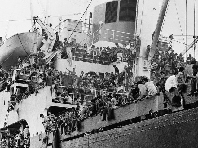 In this April 23, 1975 photo provided by the Department of Defense, Vietnamese refugees crowd aboard the Military Sealift Command ship Pioneer Contender to be evacuated to areas further south. (Photo by Department of Defense via AP Photo)