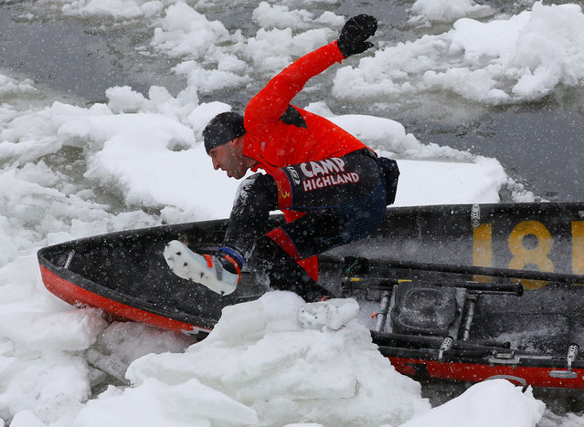 A canoer jumps over a block of ice during the Ice Canoe race at the Quebec Winter Carnival in Quebec City, February 5, 2017. (Photo by Mathieu Belanger/Reuters)