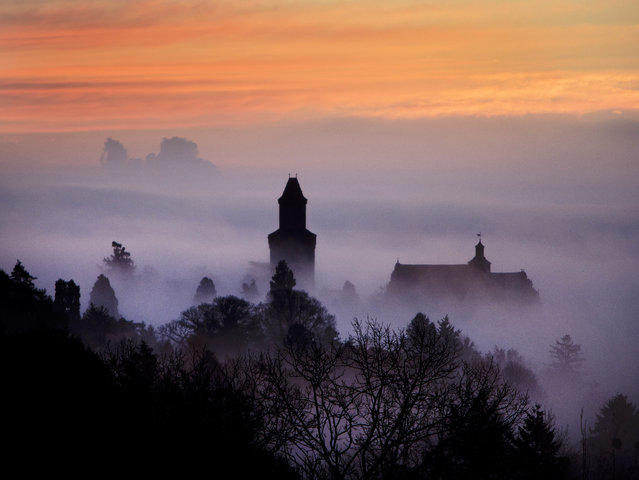 The castle of Kronberg looks out of the fog that covers the city of Frankfurt, Germany, Wednesday, November 14, 2018. (Photo by Michael Probst/AP Photo)