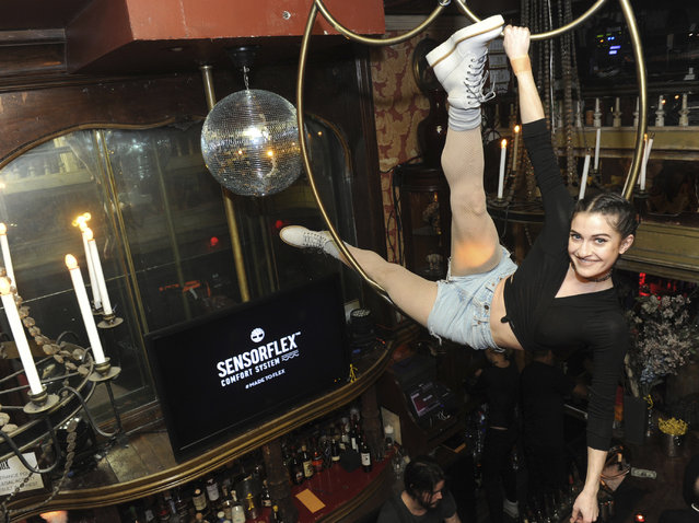An aerial artist performs at Timberland's SensorFlex Spring launch at the Box in New York, Tuesday, February 7, 2017. (Photo by Diane Bondareff/Invision for Timberland/AP Images)