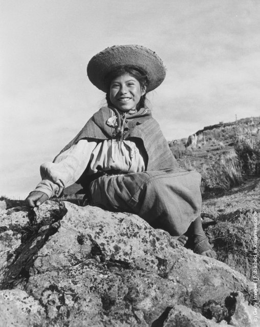A Peruvian girl, descendant of the ancient Incas, sits near her home in the Andes, 1955