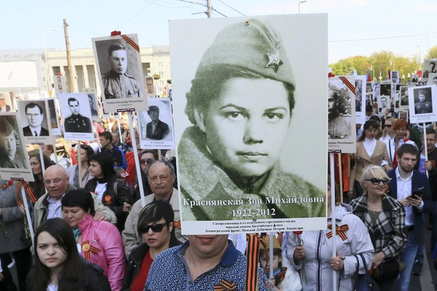 People take part in Immortal Regiment march with pictures of World War Two soldiers during the Victory Day celebrations in Kaliningrad, Russia, May 9, 2015. (Photo by Reuters/Host Photo Agency/RIA Novosti)