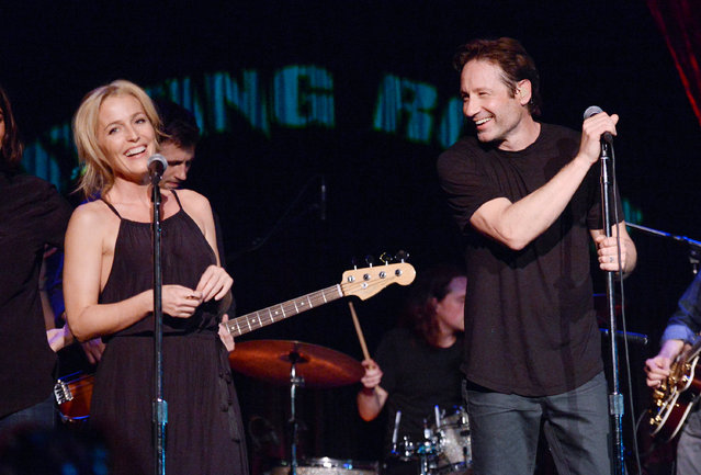 "David Duchovny is joined by actress Gillian Anderson during his performance at The Cutting Room, in support of the release of his debut album ""Hell Or Highwater"", on Tuesday, May 12, 2015, in New York. (Photo by Evan Agostini/Invision/AP Photo)"