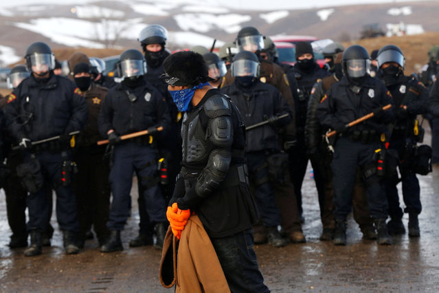 Police confront protesters refusing to evacuate the main opposition camp against the Dakota Access oil pipeline near Cannon Ball, North Dakota, U.S., February 22, 2017. (Photo by Terray Sylvester/Reuters)