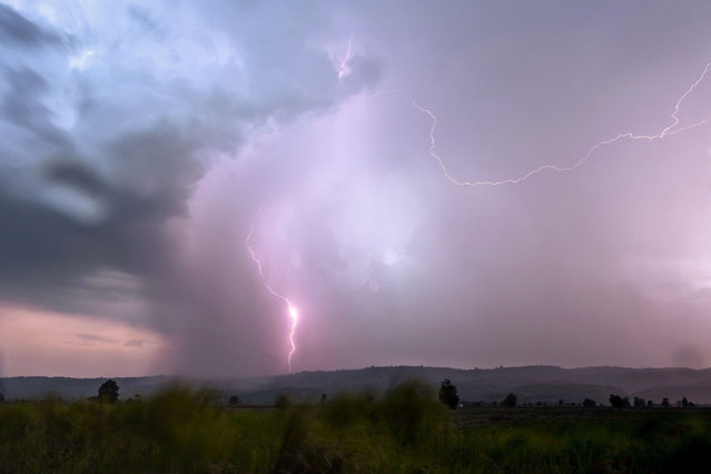 A lightning strikes over Bago Mountains in Bago Region, some 170 km from Yangon, Myanmar on May 19, 2019. (Photo by Ye Aung Thu/AFP Photo)