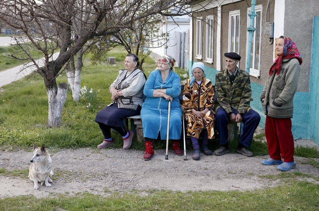 Local residents gather in a settlement of the Novoselitsky district, where a police station was recently attacked, in Stavropol region, southern Russia, April 11, 2016. (Photo by Eduard Korniyenko/Reuters)