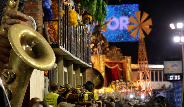 A reveller is helped after an accident with a float during the second night of the carnival parade at the Sambadrome in Rio de Janeiro, Brazil, February 28, 2017. (Photo by Ricardo Moraes/Reuters)