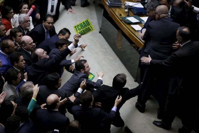 """Congressmen, who support or oppose the impeachment, argue during a session to review the request for Brazilian President Dilma Rousseff's impeachment, at the Chamber of Deputies in Brasilia, Brazil April 17, 2016. The sign reads """"Bye Dear"""". (Photo by Ueslei Marcelino/Reuters)"""